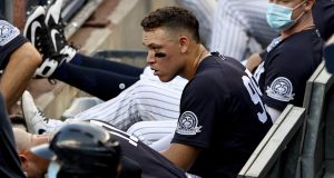 NEW YORK, NEW YORK - JULY 20: Aaron Judge #99 of the New York Yankees looks on from the dugout in the bottom of the first inning against the Philadelphia Phillies during a Summer Camp game at Yankee Stadium on July 20, 2020 in the Bronx borough of New York City.
