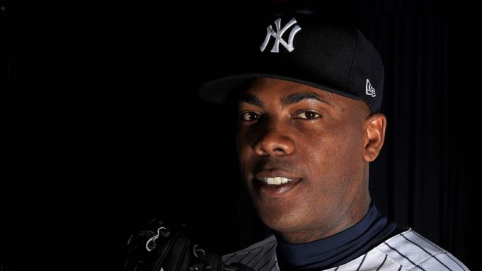 TAMPA, FLORIDA - FEBRUARY 20: Aroldis Chapman #54 of the New York Yankees poses for a portrait during photo day on February 20, 2020 in Tampa, Florida.