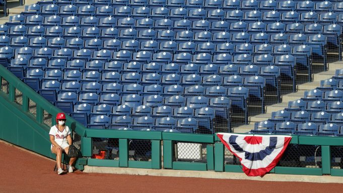 PHILADELPHIA, PA - JULY 25: The right field ball girl sits alone during a game between the Miami Marlins and the Philadelphia Phillies at Citizens Bank Park on July 25, 2020 in Philadelphia, Pennsylvania. The 2020 season had been postponed since March due to the COVID-19 pandemic.