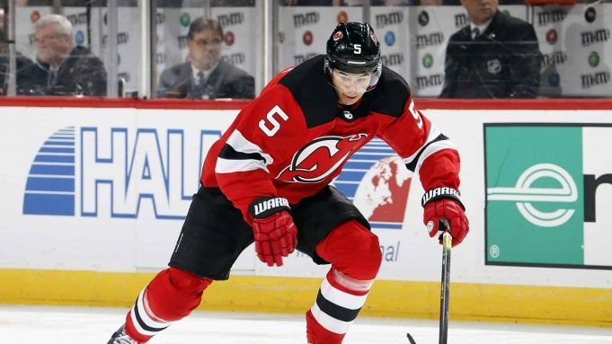 NEWARK, NJ - MARCH 30: Connor Carrick #5 of the New Jersey Devils skates during an NHL hockey game against the St. Louis Blues at the Prudential Center in Newark, New Jersey. Blues won 3-2.