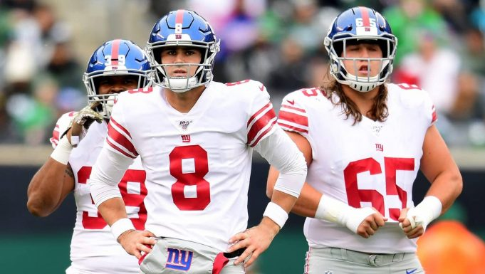EAST RUTHERFORD, NEW JERSEY - NOVEMBER 10: Daniel Jones #8 and Nick Gates #65 of the New York Giants look on during the first half of their game against the New York Jets at MetLife Stadium on November 10, 2019 in East Rutherford, New Jersey.