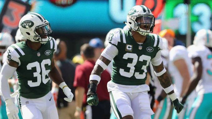 EAST RUTHERFORD, NJ - SEPTEMBER 16: Defensive back Jamal Adams #33 of the New York Jets celebrates a stop for a fourth down against the Miami Dolphins during the first quarter at MetLife Stadium on September 16, 2018 in East Rutherford, New Jersey.