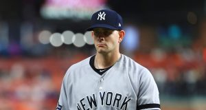 HOUSTON, TEXAS - OCTOBER 13: James Paxton #65 of the New York Yankees walks to the dugout after pitching during the first inning against the Houston Astros in game two of the American League Championship Series at Minute Maid Park on October 13, 2019 in Houston, Texas.