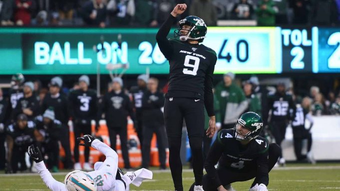 EAST RUTHERFORD, NEW JERSEY - DECEMBER 08: Sam Ficken #9 of the New York Jets kicks the game-winning field goal as Lac Edwards #4 placeholds during the second half of the game against the Miami Dolphins at MetLife Stadium on December 08, 2019 in East Rutherford, New Jersey. The New York Jets defeat the Miami Dolphins 22-21.