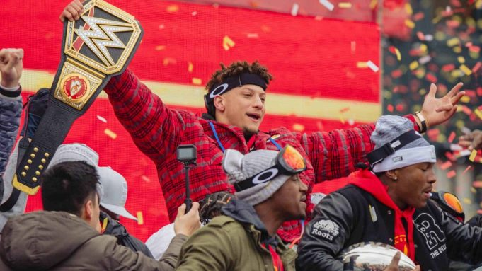 KANSAS CITY, MO - FEBRUARY 05: Patrick Mahomes #15 of the Kansas City Chiefs celebrates with a heavy weight title belt during the Kansas City Chiefs Victory Parade on February 5, 2020 in Kansas City, Missouri.