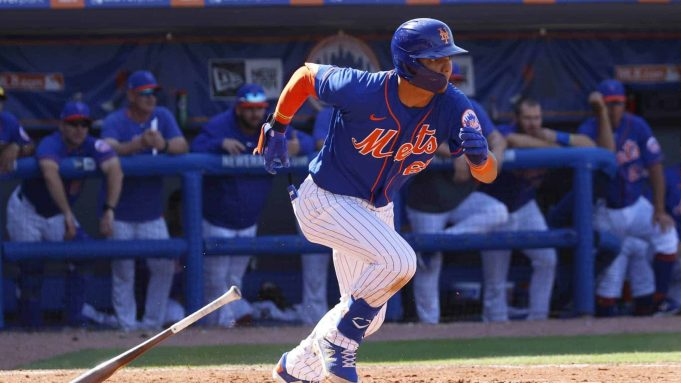 PORT ST LUCIE, FL - MARCH 4: Andres Gimenez #60 of the New York Mets hits the ball against the St Louis Cardinals during a spring training game at Clover Park on March 4, 2020 in Port St. Lucie, Florida.