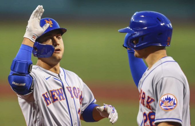 BOSTON, MA - JULY 27: Michael Conforto #30 of the New York Mets high fives J.D. Davis #28 after hitting a two-run home run in the second inning of a game against the Boston Red Sox at Fenway Park on July 27, 2020 in Boston, Massachusetts.