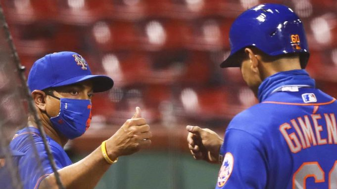 BOSTON, MA - JULY 28: Manager Luis Rojas and Andres Gimenez #60 of the New York Mets celebrates after Gimenez scored in the eighth inning against the Boston Red Sox at Fenway Park on July 28, 2020 in Boston, Massachusetts.