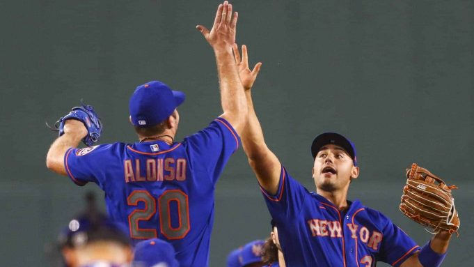 BOSTON, MA - JULY 28: Pete Alonso #20 of the New York Mets high fives Michael Conforto #30 after a victory over the Boston Red Sox at Fenway Park on July 28, 2020 in Boston, Massachusetts.