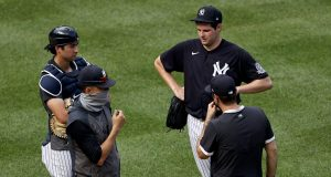 NEW YORK, NEW YORK - JULY 04: Manager Aaron Boone talks with Jordan Montgomery #47 of the New York Yankees during summer workouts at Yankee Stadium on July 04, 2020 in the Bronx borough of New York City.