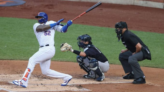NEW YORK, NEW YORK - JULY 18: Yoenis Cespedes #52 of the New York Mets bats against the New York Yankees during their Pre Season game at Citi Field on July 18, 2020 in New York City.
