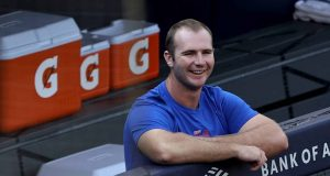 NEW YORK, NEW YORK - JULY 19: Pete Alonso #20 of the New York Mets smiles from the dugout before batting practice before a Summer Camp game against the New York Yankees at Yankee Stadium on July 19, 2020 in the Bronx borough of New York City.