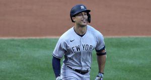 WASHINGTON, DC - JULY 23: Giancarlo Stanton #27 of the New York Yankees rounds the bases after hitting a two run home run to center field against Max Scherzer #31 of the Washington Nationals during the first inning in the game at Nationals Park on July 23, 2020 in Washington, DC.