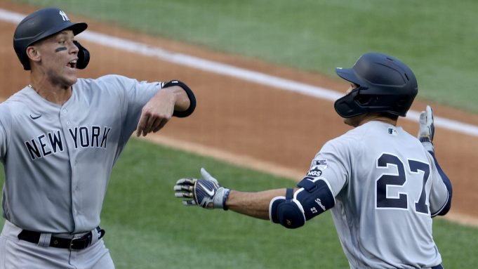 WASHINGTON, DC - JULY 23: Giancarlo Stanton #27 of the New York Yankees celebrates with Aaron Judge #99 after hitting a two run home run to center field against Max Scherzer #31 of the Washington Nationals during the first inning in the game at Nationals Park on July 23, 2020 in Washington, DC.