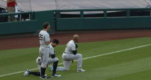 WASHINGTON, DC - JULY 25: Giancarlo Stanton and Aaron Hicks of the New York Yankees kneel during the national anthem before playing against the Washington Nationals at Nationals Park on July 25, 2020 in Washington, DC.