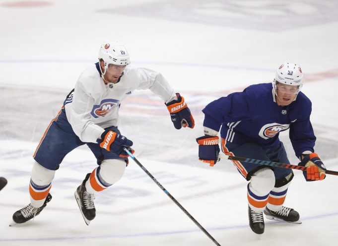 EAST MEADOW, NEW YORK - JULY 13: (L-R) Brock Nelson #29 and Casey Cizikas #53 of the New York Islanders skate in practice at the Northwell Health Ice Center on July 13, 2020 in East Meadow, New York. This is the first practice for the team since the NHL paused it's season due to the coronavirus pandemic.
