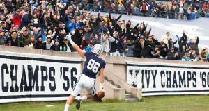 NEW HAVEN, CT - NOVEMBER 18: JP Shohfi #88 of the Yale Bulldogs reacts after scoring a touchdown in the first half of a game against the Harvard Crimson at the Yale Bowl on November 18, 2017 in New H