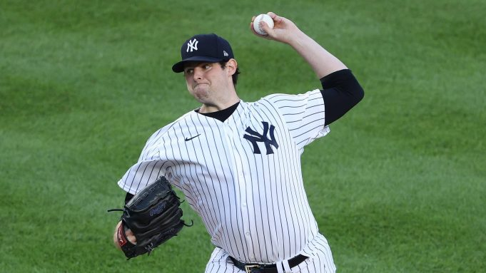 NEW YORK, NEW YORK - JULY 31: Jordan Montgomery #47 of the New York Yankees pitches against the Boston Red Sox during their home opener at Yankee Stadium on July 31, 2020 in New York City. The 2020 season had been postponed since March due to the COVID-19 pandemic.