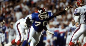 TAMPA, FL - JANUARY 27: Defensive tackle Leonard Marshall #70 of the New York Giants pressures quarterback Jim Kelly #12 of the Buffalo Bills during Super Bowl XXV at Tampa Stadium on January 27, 1991 in Tampa, Florida. The Giants defeated the Bills 20-19.