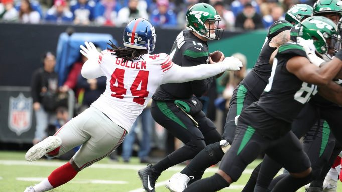 EAST RUTHERFORD, NEW JERSEY - NOVEMBER 10: Sam Darnold #14 of the New York Jets is wrapped up by Markus Golden #44 of the New York Giants during their game at MetLife Stadium on November 10, 2019 in East Rutherford, New Jersey.