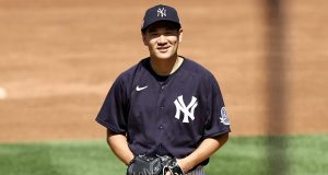 NEW YORK, NEW YORK - JULY 04: Masahiro Tanaka #19 of the New York Yankees works from the pitcher's mound during summer workouts at Yankee Stadium on July 04, 2020 in the Bronx borough of New York City.