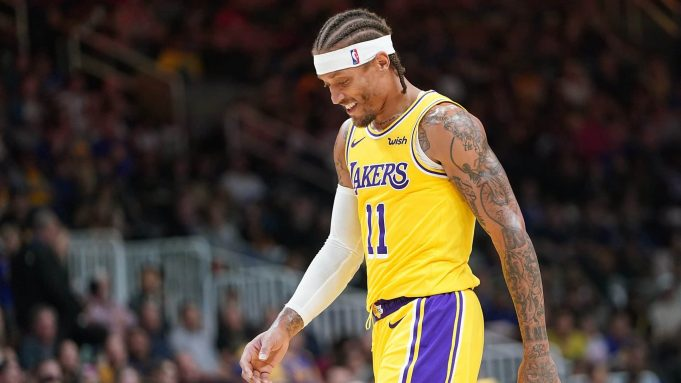 SAN JOSE, CA - OCTOBER 12: Michael Beasley #11 of the Los Angeles Lakers walks off the court smiling after he received two technical fouls and was ejected from the game against the Golden State Warriors during the second half of their NBA preseason basketball game at SAP Center on October 12, 2018 in San Jose, California. NOTE TO USER: User expressly acknowledges and agrees that, by downloading and or using this photograph, User is consenting to the terms and conditions of the Getty Images License Agreement.