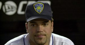 21 Sep 2001: Mike Piazza wearing his Port Authority Police hat in honor of the victims of the World Trade Center attacks before the Mets game against the Atlanta Braves at Shea Stadium in Flushing, New York .