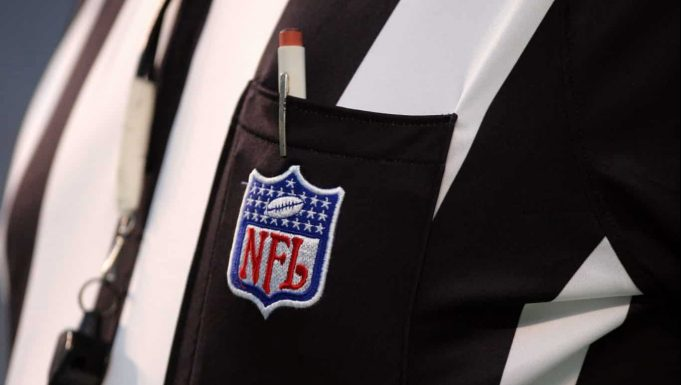 CHARLOTTE, NC - AUGUST 12: Detail of the NFL logo on the shirt of an official during the preseason game between the Buffalo Bills and the Carolina Panthers at Bank of America Stadium on August 12, 2006 in Charlotte, North Carolina. The Panthers won 14-13.