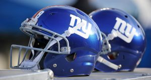 NASHVILLE, TN - DECEMBER 07: Helmets of the New York Giants rests on the sideline during a game against the Tennessee Titans at LP Field on December 7, 2014 in Nashville, Tennessee.