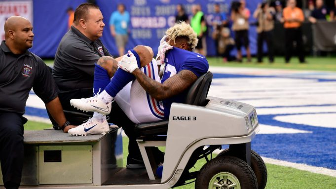 EAST RUTHERFORD, NJ - OCTOBER 08: Odell Beckham #13 of the New York Giants is carted off the field after sustaining an injury during the fourth quarter against the Los Angeles Chargers during an NFL game at MetLife Stadium on October 8, 2017 in East Rutherford, New Jersey. The Los Angeles Chargers defeated the New York Giants 27-22.