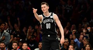 NEW YORK, NEW YORK - OCTOBER 25: Rodions Kurucs #00 of the Brooklyn Nets celebrates his three-pointer in the first half of their game against the New York Knicks at Barclays Center on October 25, 2019 in the Brooklyn borough of New York City. NOTE TO USER: User expressly acknowledges and agrees that, by downloading and or using this photograph, User is consenting to the terms and conditions of the Getty Images License Agreement.