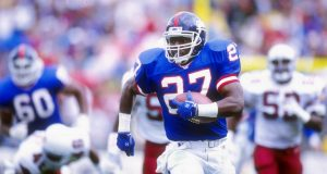 10 Nov 1991: Running back Rodney Hampton of the New York Giants runs with the ball during a game against the Phoenix Cardinals at Sun Devil Stadium in Tempe, Arizona. The Giants won the game 21-14.