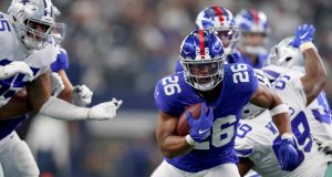 ARLINGTON, TEXAS - SEPTEMBER 08: Saquon Barkley #26 of the New York Giants carries the ball against Chidobe Awuzie #24 of the Dallas Cowboys in the third quarter at AT&T Stadium on September 08, 2019 in Arlington, Texas.