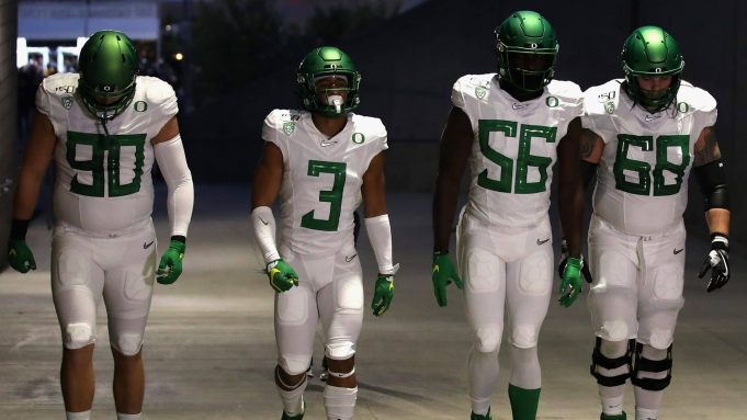 TEMPE, ARIZONA - NOVEMBER 23: (L-R) Defensive tackle Drayton Carlberg #90, wide receiver Johnny Johnson III #3, linebacker Bryson Young #56 and offensive lineman Shane Lemieux #68 of the Oregon Ducks walk to the field before the NCAAF game against the Arizona State Sun Devils at Sun Devil Stadium on November 23, 2019 in Tempe, Arizona.