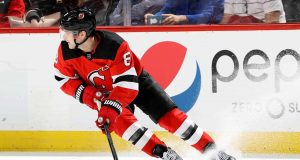 NEWARK, NEW JERSEY - FEBRUARY 11: Will Butcher #8 of the New Jersey Devils takes the puck in the third period against the Florida Panthers at Prudential Center on February 11, 2020 in Newark, New Jersey.The Florida Panthers defeated the New Jersey Devils 5-3.