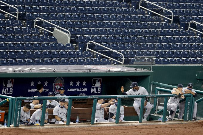 WASHINGTON, DC - JULY 23: The New York Yankees dugout reacts during the fourth inning in the game against the Washington Nationals at Nationals Park on July 23, 2020 in Washington, DC.