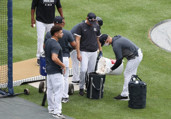 NEW YORK, NEW YORK - JULY 08: Fresh baseballs are poured in a bucket for batting practice during the New York Yankees summer workouts at Yankee Stadium on July 08, 2020 in the Bronx borough of New York City.