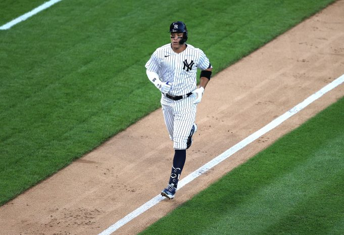 NEW YORK, NEW YORK - JULY 31: Aaron Judge #99 of the New York Yankees rounds the bases after hitting a third inning two run home run against the Boston Red Sox during their home opener at Yankee Stadium on July 31, 2020 in New York City. The 2020 season had been postponed since March due to the COVID-19 pandemic.