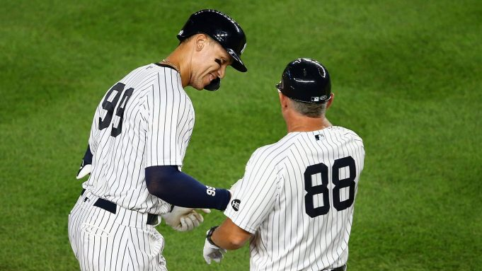 NEW YORK, NEW YORK - AUGUST 02: Aaron Judge #99 of the New York Yankees celebrates after hitting a 2-run home run in the bottom of the eighth inning against the Boston Red Sox at Yankee Stadium on August 02, 2020 in New York City.