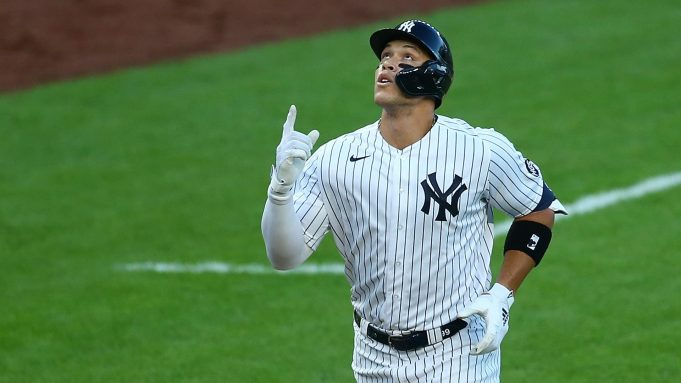 NEW YORK, NEW YORK - AUGUST 01: Aaron Judge #99 of the New York Yankees points to the sky after hitting a first inning home run against the Boston Red Sox at Yankee Stadium on August 01, 2020 in New York City.