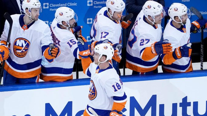 TORONTO, ONTARIO - AUGUST 07: Anthony Beauvillier #18 of the New York Islanders is congratulated by teammates on the bench after he scored a goal in the first period against the Florida Panthers in Game Four of the Eastern Conference Qualification Round prior to the 2020 NHL Stanley Cup Playoffs at Scotiabank Arena on August 07, 2020 in Toronto, Ontario.