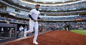 NEW YORK, NEW YORK - OCTOBER 15: Aroldis Chapman #54 of the New York Yankees takes the field as he is introduced prior to game three of the American League Championship Series against the Houston Astros at Yankee Stadium on October 15, 2019 in New York City.
