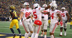 ANN ARBOR, MICHIGAN - NOVEMBER 30: Garrett Wilson #5 of the Ohio State Buckeyes celebrates his second half touchdown against the Michigan Wolverines at Michigan Stadium on November 30, 2019 in Ann Arbor, Michigan. Ohio State won the game 56-27.