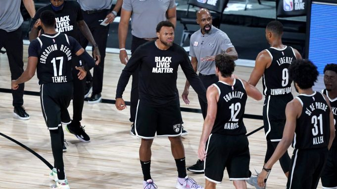 LAKE BUENA VISTA, FLORIDA - AUGUST 13: Justin Anderson of the Brooklyn Nets reacts as teammates walk off the floor for a timeout in the second half against the Portland Trail Blazers at AdventHealth Arena at ESPN Wide World Of Sports Complex on August 13, 2020 in Lake Buena Vista, Florida. NOTE TO USER: User expressly acknowledges and agrees that, by downloading and or using this photograph, User is consenting to the terms and conditions of the Getty Images License Agreement.