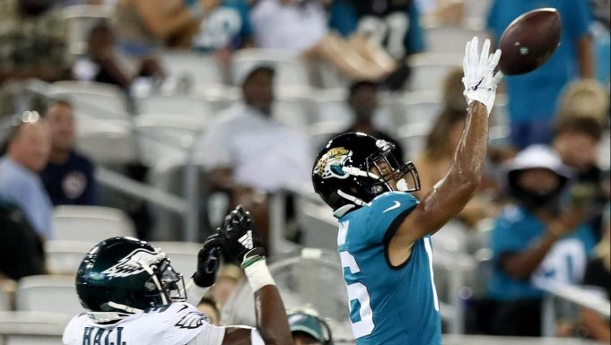JACKSONVILLE, FLORIDA - AUGUST 15: C.J. Board #16 of the Jacksonville Jaguars catches a pass against Deiondre' Hall #36 of the Philadelphia Eagles in the second quarter during a preseason game at TIAA Bank Field on August 15, 2019 in Jacksonville, Florida.