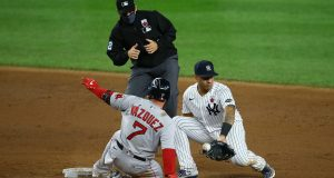 NEW YORK, NEW YORK - AUGUST 16: Christian Vazquez #7 of the Boston Red Sox slides in for a double as the ball get by Gleyber Torres #25 of the New York Yankees in the ninth inning at Yankee Stadium on August 16, 2020 in New York City.