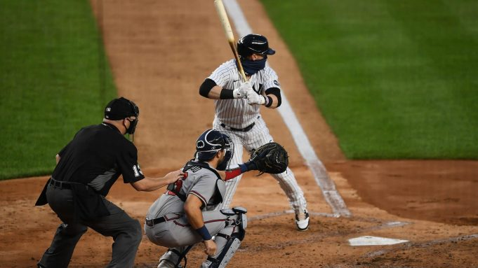 NEW YORK, NEW YORK - AUGUST 12: Clint Frazier #77 of the New York Yankees bats in the second inning against the Atlanta Braves at Yankee Stadium on August 12, 2020 in the Bronx borough of New York City. Frazier hit a home run to tie the game 2-2.