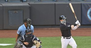 NEW YORK, NEW YORK - JULY 14: Clint Frazier #77 of the New York Yankees takes his at bat as Kyle Higashioka #66 of the New York Yankees catches during an intrasquad game of summer workouts at Yankee Stadium on July 14, 2020 in the Bronx borough of New York City.Both players wore face coverings.