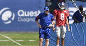 EAST RUTHERFORD, NEW JERSEY - AUGUST 21: Offensive coordinator Jason Garrett looks on with Daniel Jones #8 of the New York Giants during training camp at NY Giants Quest Diagnostics Training Center on August 21, 2020 in East Rutherford, New Jersey.