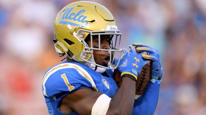 PASADENA, CA - SEPTEMBER 01: Darnay Holmes #1 of the UCLA Bruins catches a punt during a 26-17 loss to the Cincinnati Bearcats at Rose Bowl on September 1, 2018 in Pasadena, California.